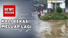 Warga Bergotong Royong Bersihkan Banjir