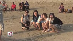 Menikmati Matahari Terbenam di Pantai Kuta